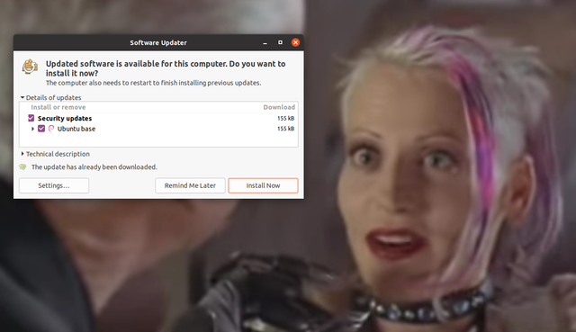"Screenshot of Ubuntu's update manager popping up during the movie ""Tank Girl."""